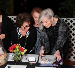 Barbara Axelband (left) checks out the silent auction